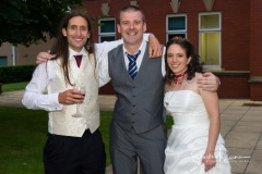 Posing with the wedding photographer at Cheadle House