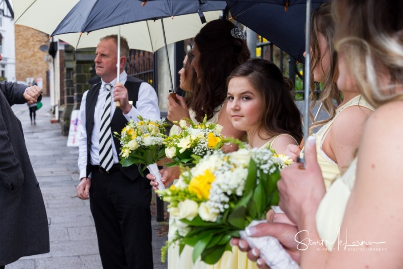 Bridesmaids waiting in the rain