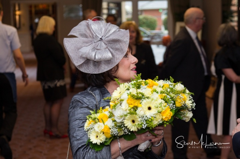 Mother of the bride holding flowers