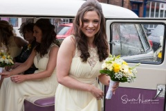 Bridesmaids with flowers outside St Mary's, Sandbach
