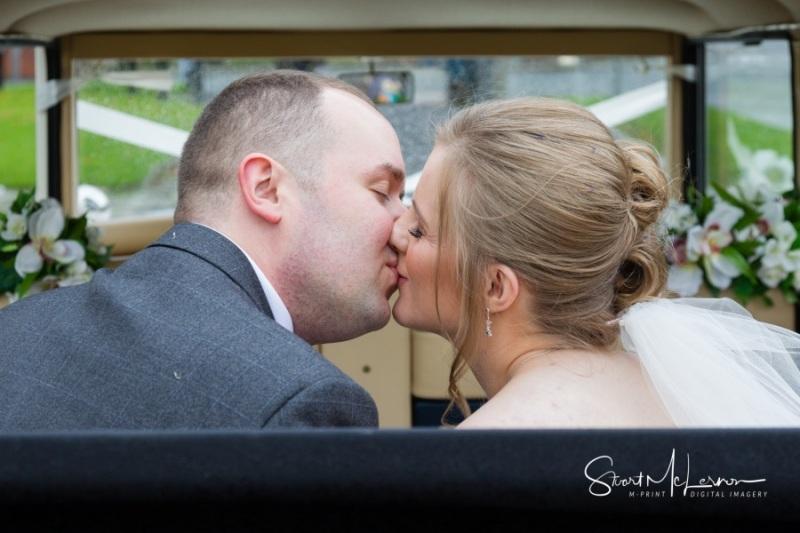 A kiss in the wedding car