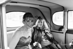 Bridesmaids in car