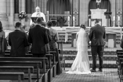 Bride and groom in front of the altar
