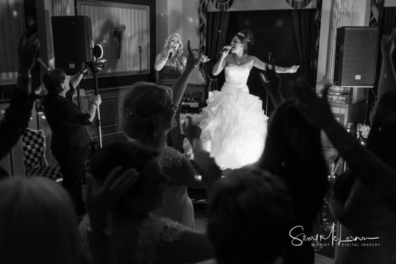 Bride serenading her husband