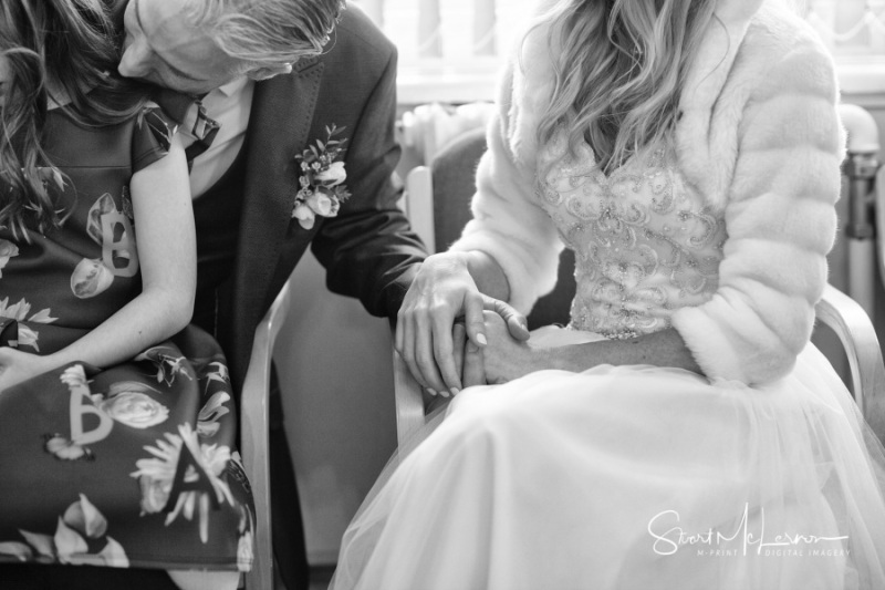 Bride and Groom holding hands at Stockport Town Hall