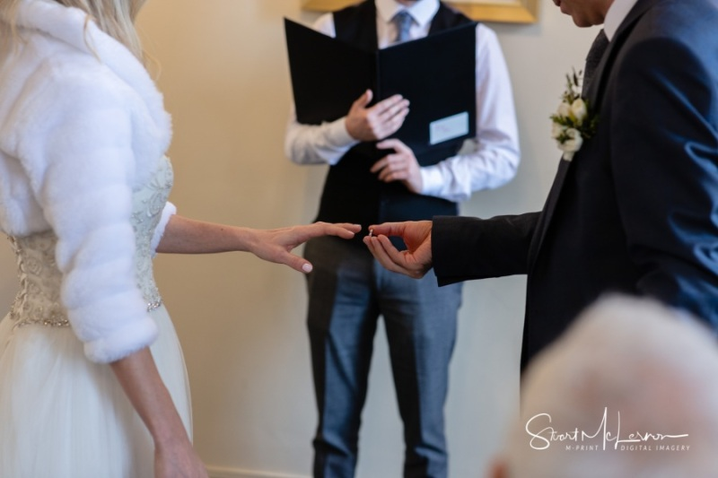 Placing the wedding ring at Stockport Town Hall