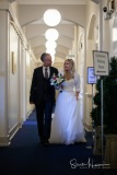 Bride and Groom making their way down the corridor of Stockport Town Hall