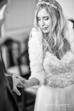Bride places ring on finger at Stockport Town Hall