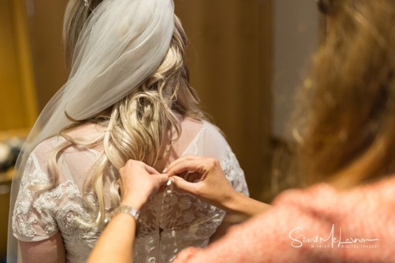 Fastening the dress