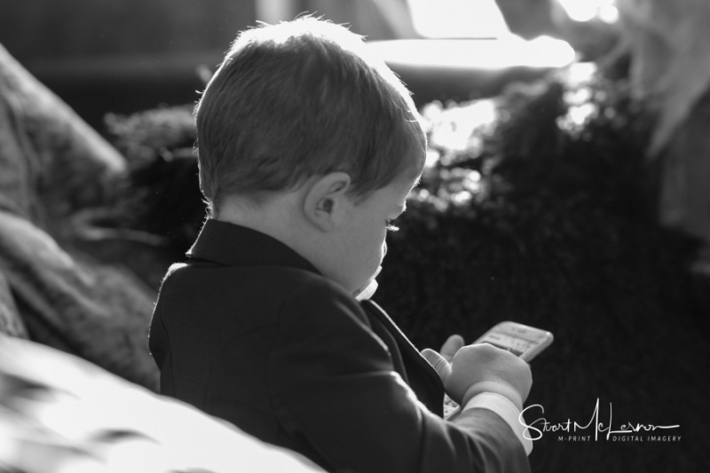Playing on his phone