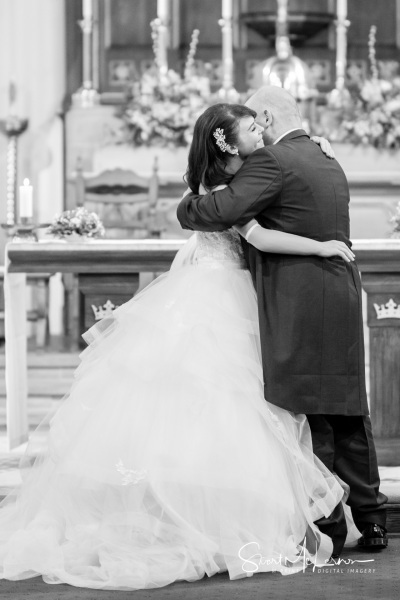 A hug at the altar