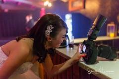 Bride looking at photographs