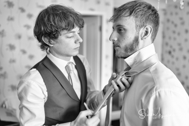 Fastening the groom's tie